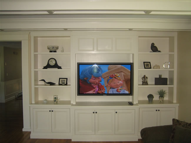 Basement built ins on pinterest traditional family rooms Built in shelves living room